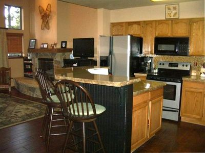 Kitchen/Breakfast Bar with granite countertops