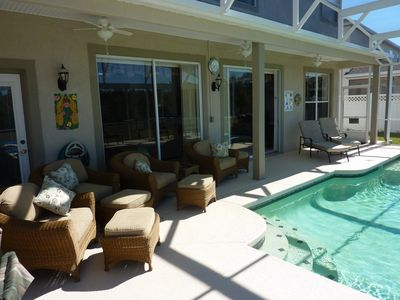 Reunion villa rental - The shade of the lanai before the dip in the oversize pool