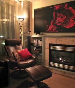 A cozy fireplace, and fine art throughout the condo set a classy ambiance!