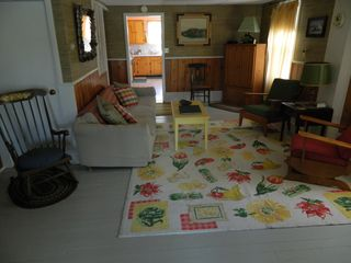 Eastbrook cottage photo - Large living room which leads to closed in porch with view of pond.