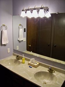 Bathroom with double sinks and linens