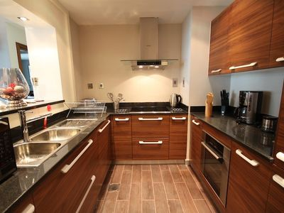 Fully fitted kitchen with granite countertops