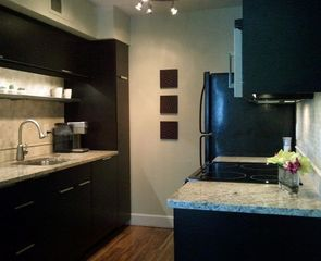 Old Town Scottsdale condo photo - Newly remodeled kitchen, granite countertops, electric range and working space.