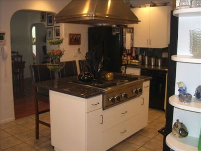 Kitchen with central cook station and indoor grill