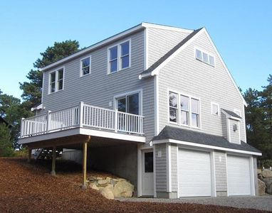 Classic, Contemporary Cape Cod-style home with fabulous deck and back yard space
