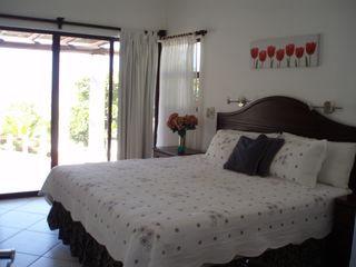 Pochomil estate photo - Our second master bedroom suite-king bed-private ensuite & exit to pool terrace