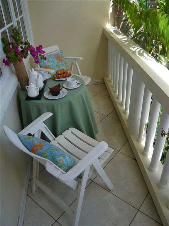 Enjoy a snack in your garden patio beside the pool.