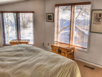 Master Bedroom w King Bed. Snowy Exterior.
