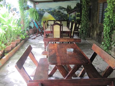 Front patio overlooking gardens & mural.. 2 tables seats 16 plus sofa & 3 chairs
