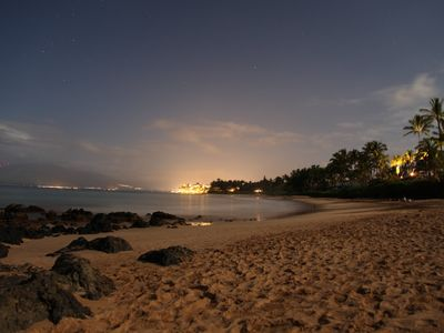 Walk along the beach at night with the stars