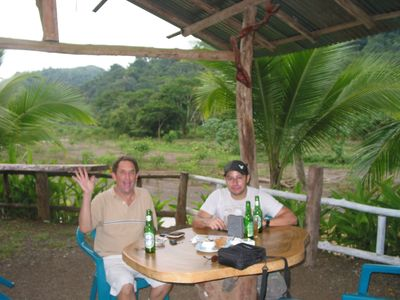Owner (on L) Enjoys Scenery with Friendly Locals