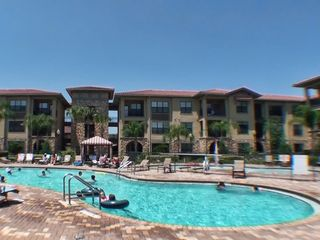 Main pool with kiddie splash zone! - Bella Piazza condo vacation rental photo