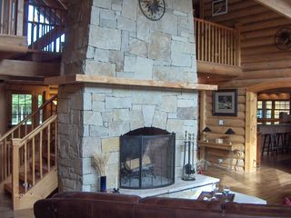 Sherman lodge photo - Adirondack stone chimney and great room fireplace