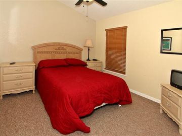 Bedroom Three with Double Bed, ceiling fan and TV.