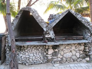 Grand Cayman condo photo - Caymanian stone bbq onsite is perfect for family cookouts