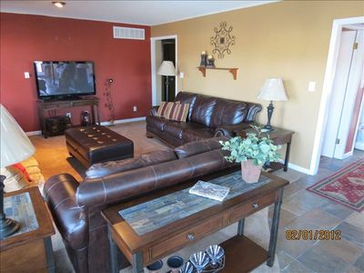 "Lake Ozark house rental - Main level living room w/ 50"" flat screen & dvd, fireplace, great view of cove"