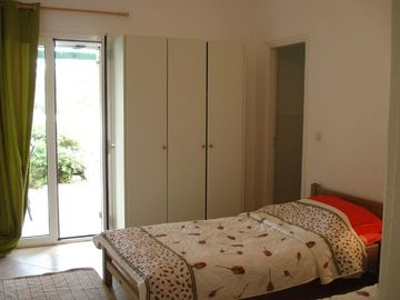 Twin bedroom opening onto garden terrace