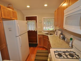 Unity cottage photo - New kitchen with granite countertops and cherry cabinets, gas stove, microwave