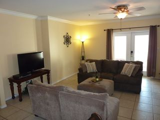 South Padre Island condo photo - Living area with french doors leading to the back patio