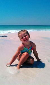 Our middle daughter playing in the sugar-like sand
