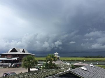 Fripp Island cottage rental - Pic take from back deck watching storm coming across marina. Awesome.