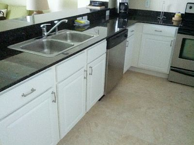 Large kitchen with granite counter and tile floors. Everything you need at home