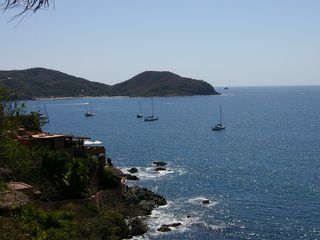 Zihuatanejo condo photo - Spacious Living room with dining room and kitchen in the background!