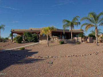 Sun City West house rental - view of back of house, pool area, patio