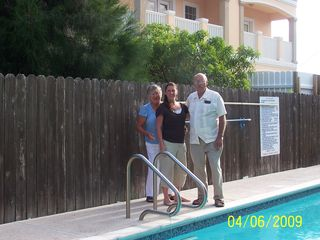 South Padre Island condo photo - That's us along with our daughter by the pool.