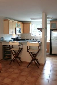 Full Kitchen with wine cooler, dishwasher, microwave, toaster oven