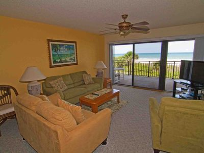 Living room and view of beach and ocean