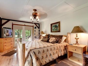 Pigeon Forge chalet rental - Spacious master suite with king log bed with access to covered porch and hot tub