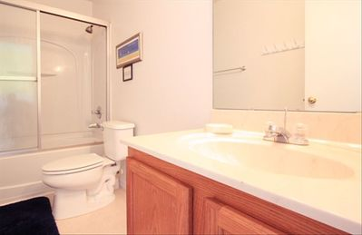 Guest bathroom upstairs with bathtub and shower