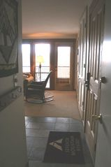Bend condo photo - entry; slate floor, deck to back.