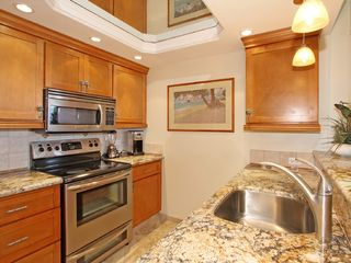 Lahaina condo photo - Kitchen has Range, Microwave, Fridge, and Dishwasher.
