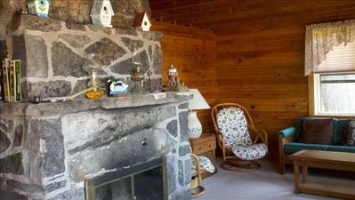 The fire place and cosy sitting area in the larger cottage