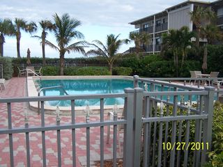 Vero Beach condo photo - Large Pool with plenty of chairs and tables