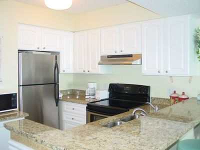 Kitchen with Stainless Appliances and Granite Countertops