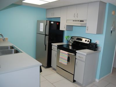 Cocoa Beach condo rental - Immaculate kitchen includes ice maker, stove and oven, microwave, dishwasher.