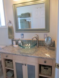 Custom designed maple bathroom vanity with vessel sink, granite countertop.