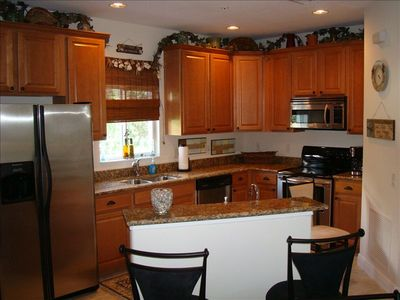 Gourmet Kitchen: stainless steel appliances & granite countertops