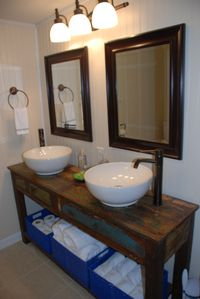Charming new bathroom with double vessel sinks and luxurious linens