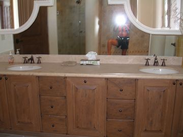 master bedroom ensuite vanity with 2 sinks and copper faucets.