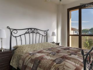 Montopoli Val d'Arno house photo - Corner bedroom enjoys two French doors and two terraces.