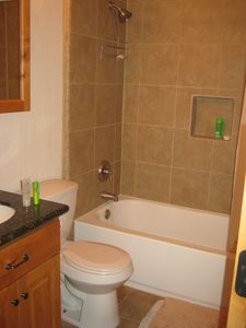 Remodeled Upstairs bath - new tub, toilet, sink, granite with new vanity