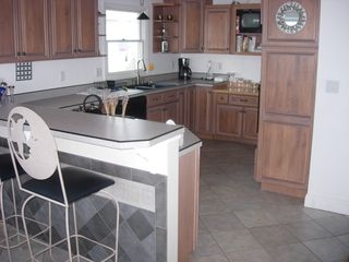 Seabrook house photo - Kitchen with stovetop grill, wall oven and microwave (everything you need)