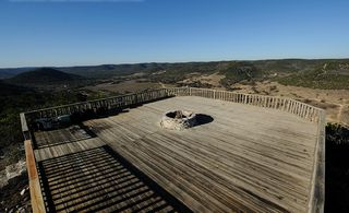 Bandera cottage photo - Deck-w-Fire-Pit....on top of Lookout mountain. A great spot to enjoy the sunset