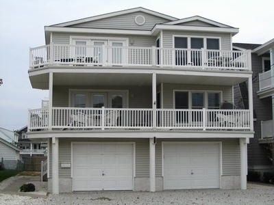 Front view of property, large deck with nice ocean views