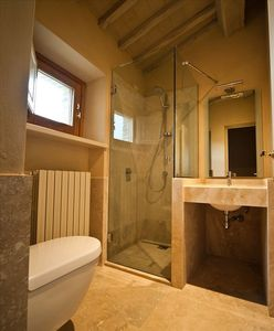 Bathroom 2 ( modern, recently buit travertine finishes)incl shower, basin, wc)