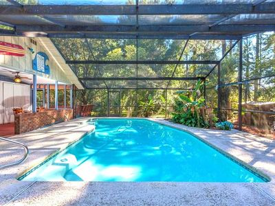 A heated, enclosed pool--just for you! - Scarlet Rose River House has its own private heated pool, enclosed in a lanai and surrounded by greenery. Enjoy a solo swim at sunrise, splash about with family throughout the day, and end the evening floating as you gaze up at the stars.